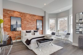 Sophisticated way to use exposed brick in your bedroom