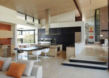 Spacious dining area and kitchen with series of internal steps dividing space