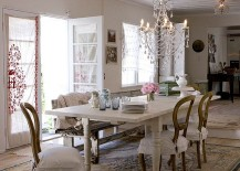 Sparkling chandelier becomes the focal point in this dining room [From: Chandi Lighting]