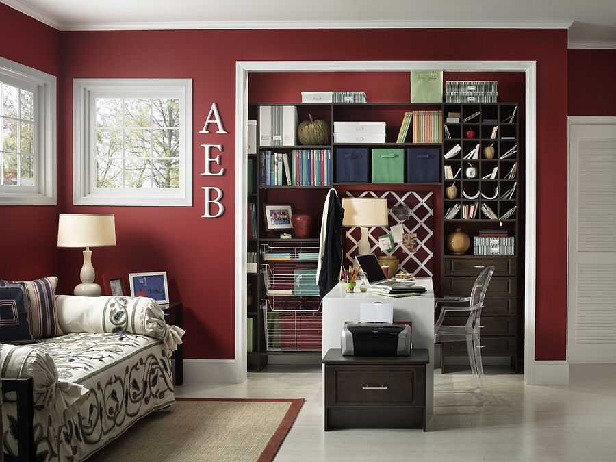Sparkling contemporary home office with white trims and maroon walls [Design: Capital Closets]