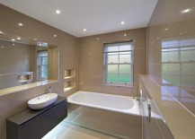 Spotlights reflect in the tile of a modern bathroom