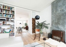 Stacked firewood and concrete fireplace add texture to the living room 217x155 Industrial Chic: Contemporary Space Conscious Dutch Apartment Renovation