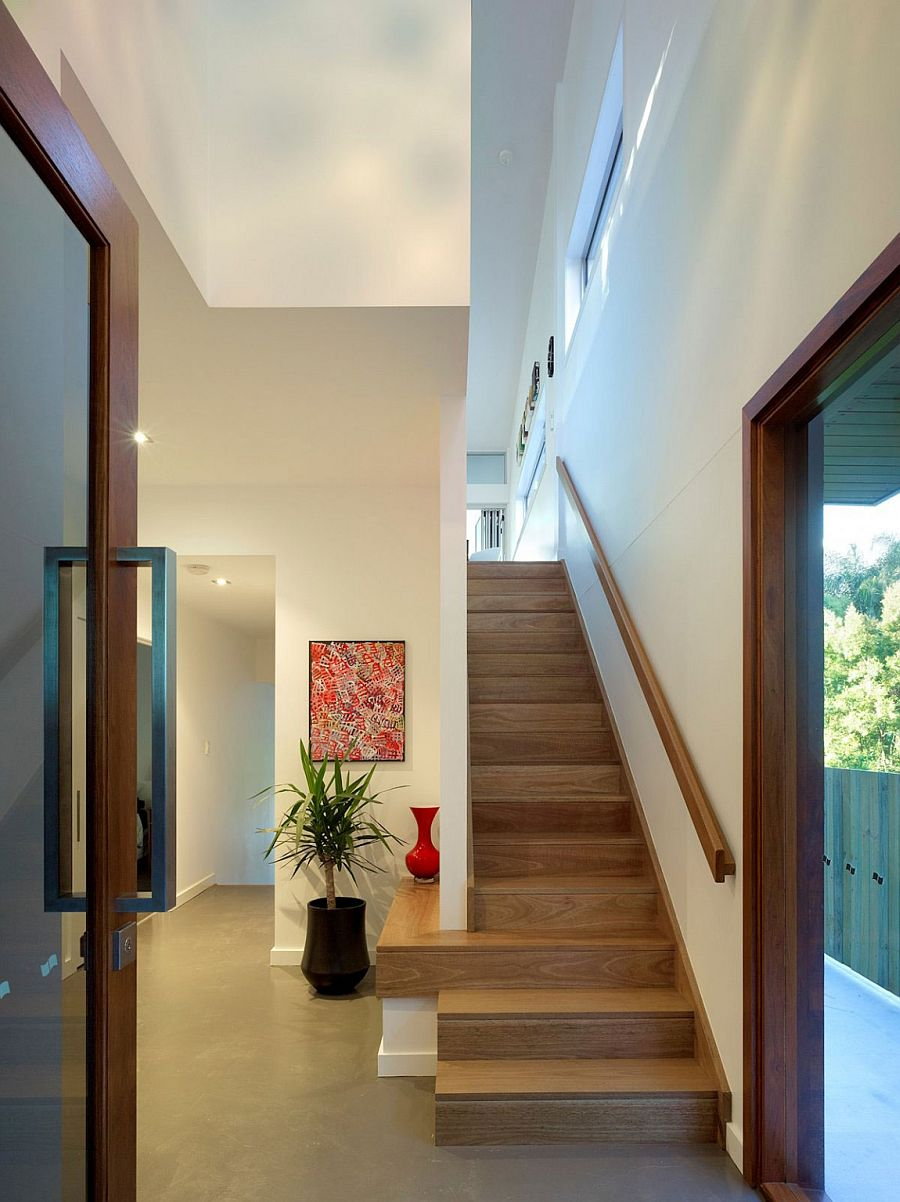 Staircase leading to the top level with bedrooms and additional living area