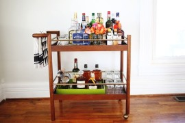 Stocked bar cart from A Beautiful Mess Stocking Your Holiday Bar Cart Stocking Your Holiday Bar Cart Stocked bar cart from A Beautiful Mess 270x180