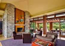 Stone and wood fireplace in the living room becomes the focal point of the modern home