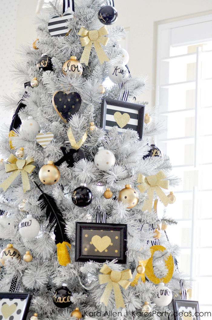 Stunning white Christmas tree with gold, black, and white decorations