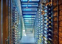 Stunning wine cellar under the staircase with limestone floor 217x155 20 Eye Catching Under Stairs Wine Storage Ideas