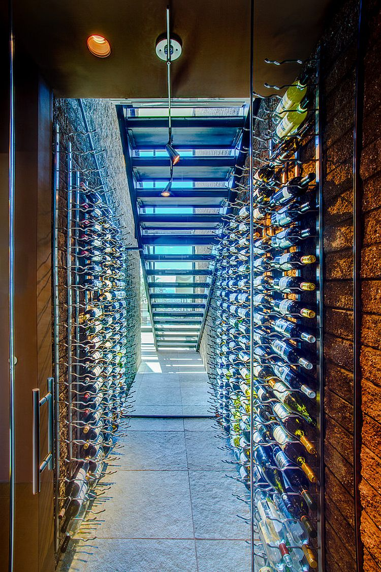 Stunning wine cellar under the staircase with limestone floor [Design: Kevin B Howard Architects]