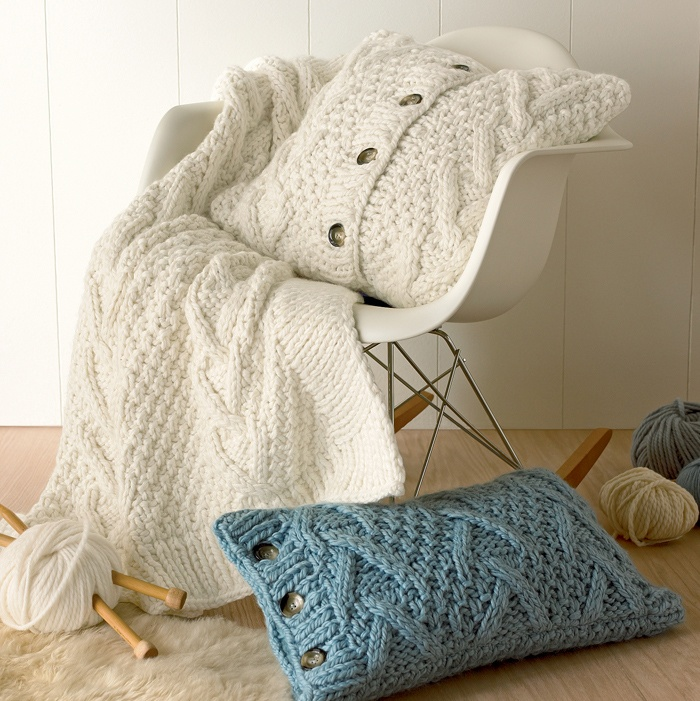 Sweater pillows with buttons