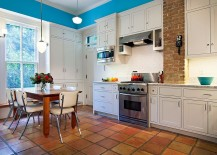 Terra-cotta tiles make their presence felt in the Victorian kitchen