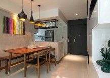Tom-Dixon-pendant-lights-bring-industrial-beuaty-to-the-home-in-Singapore-217x155