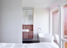 Top-level-bedroom-and-bathroom-draped-in-white-217x155