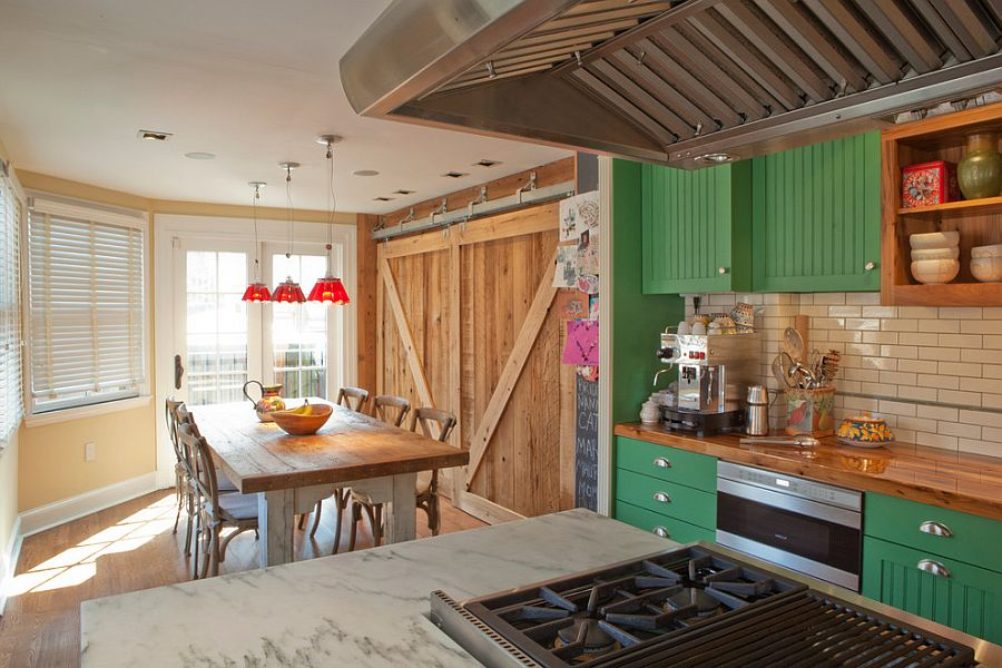 Traditional kitchen with woodsy barn doors in the backdrop [Design: Michael Gruber Design / Photography: Mark Havens]