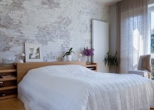 Transitional-bedroom-lets-the-brick-wall-shine-through-217x155