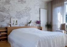 Transitional bedroom lets the brick wall shine through [Design: Nasciturus Design]