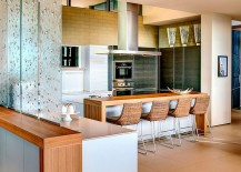 Translucent glass panes create a cool partition between the living area and kitchen