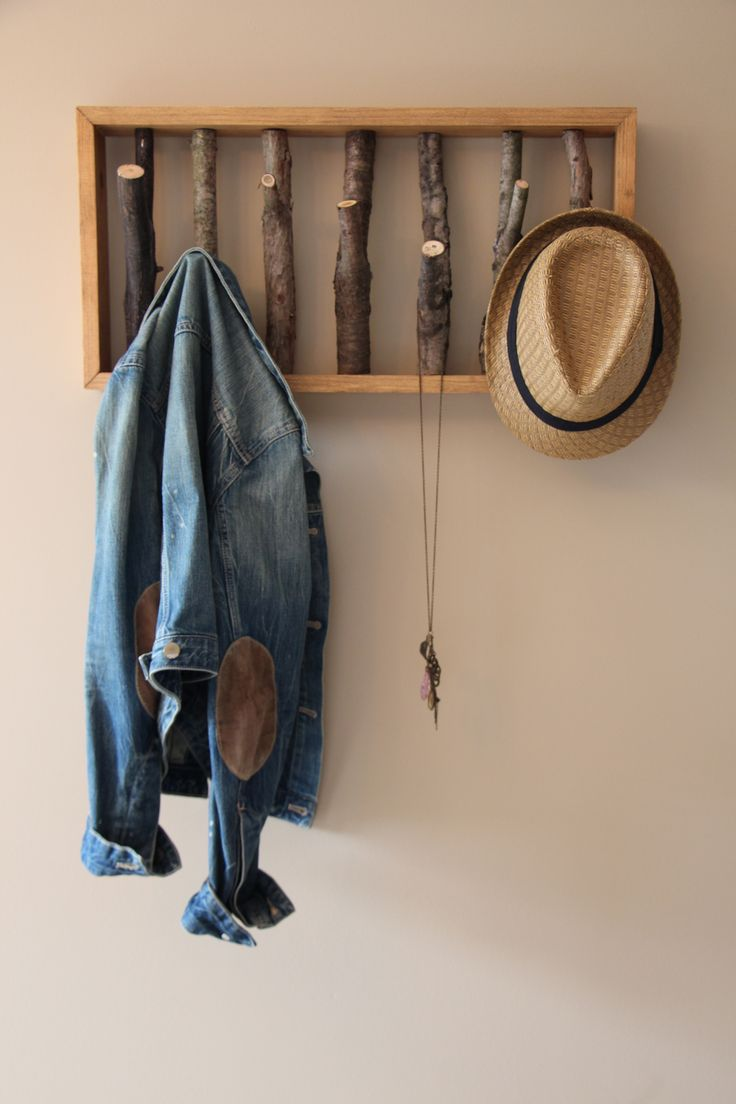 Tree branch coat hanger to hang on a wall