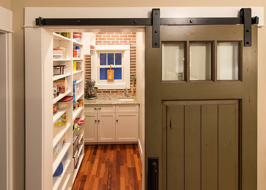 Turn that old door into a sliding barn-style door for the pantry [Design: HighCraft Builders]