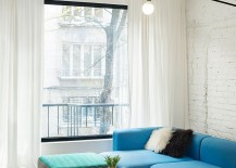 Twin-coffee-tables-create-a-visual-link-between-the-living-space-and-dining-area-217x155