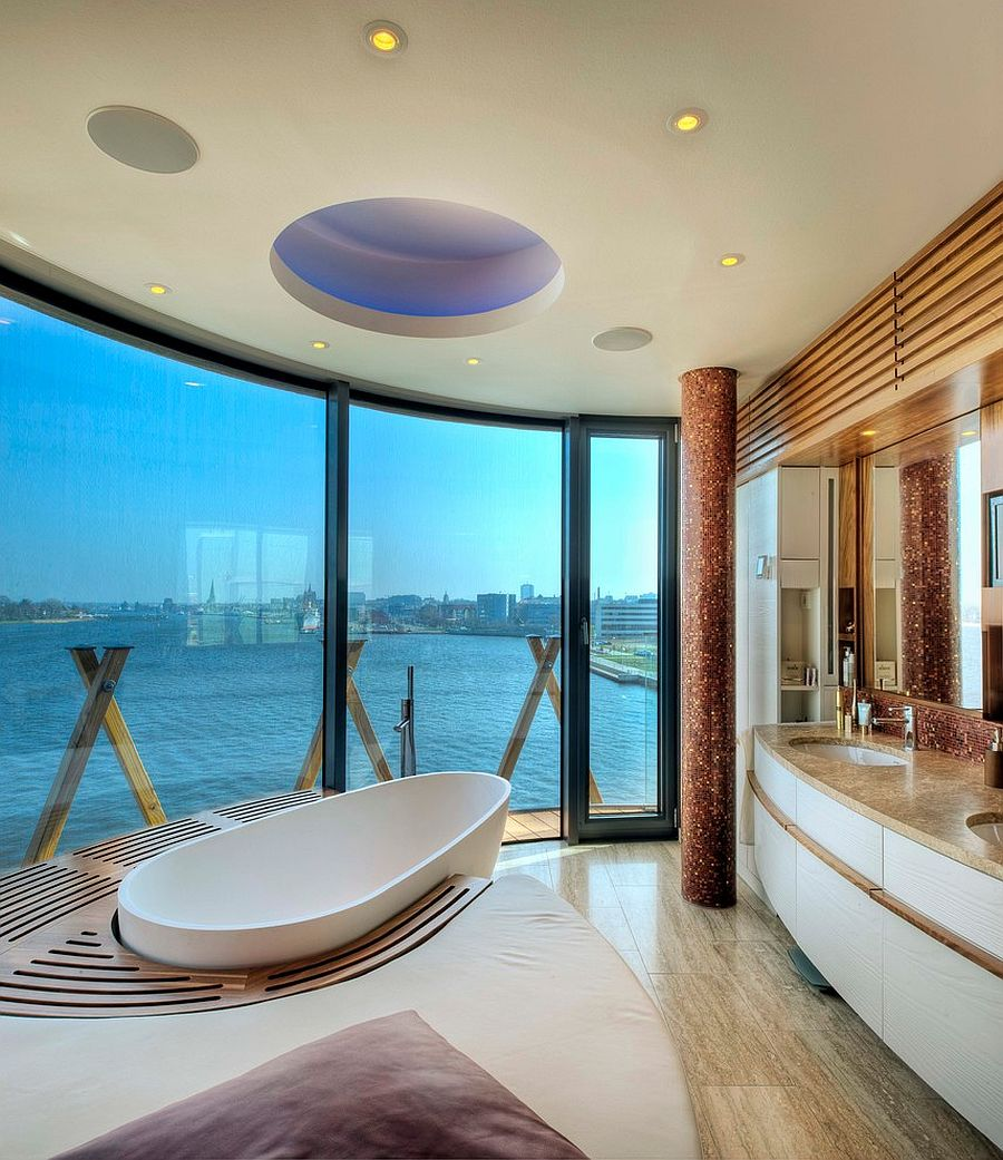 View in gallery Unique bathroom design and bathtub make most of the view on  offer [Design: baustudio