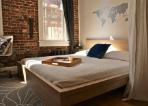 Unique modern bedroom design features wall decal and brick wall [Design: Beekman Lane]