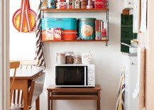 Unique storage features add to the allure of the shabby chic kitchen [Photography: Hilda Grahnat]