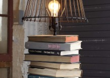 Upcycled industrial lamp with books for its base