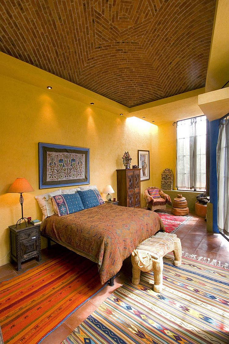 Vibrant bedroom showcases a blend of exotic styles and hues [Design: House + House Architects]