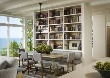 Wall of books also helps delineate space inside this contemporary home
