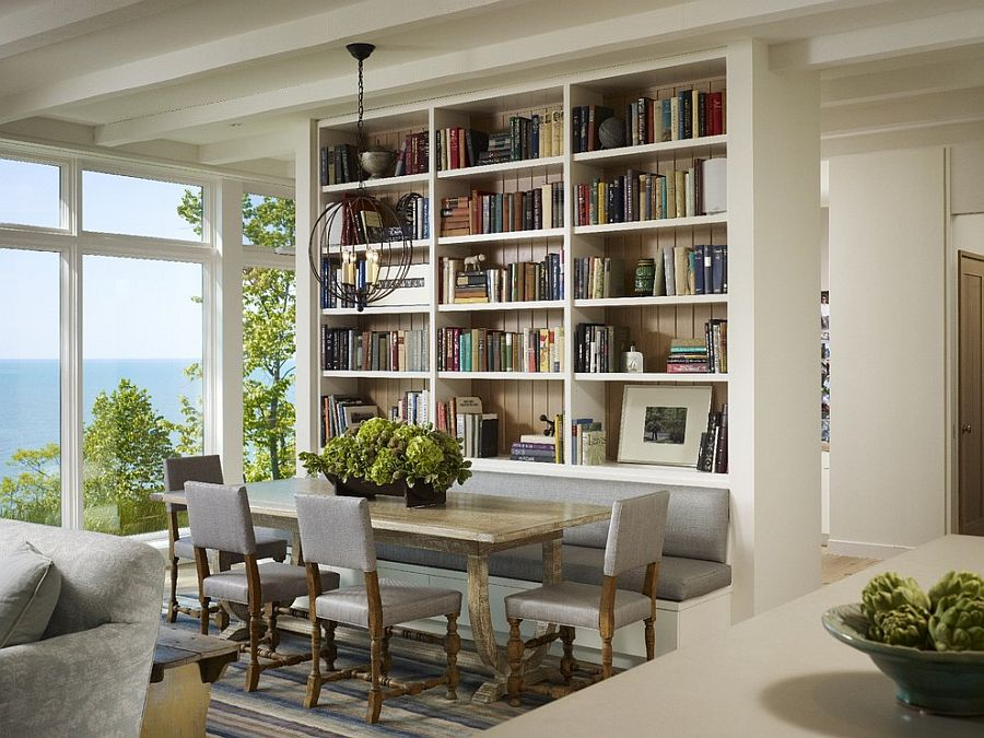 Wall of books also helps delineate space inside this contemporary home [Design: Robbins Architecture]