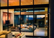 Wall-of-glass-visually-connects-the-living-area-with-the-patio-217x155