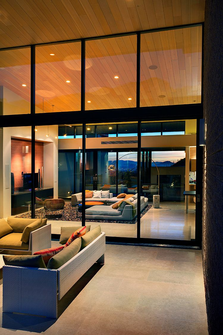 Wall of glass visually connects the living area with the patio