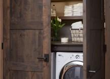 Washer and dryer hidden in closet with beautiful dark wooden doors