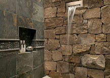 Waterfall shower head is a perfect fit for the fabulous stone wall in the bathroom