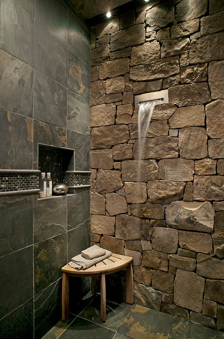 Waterfall shower head is a perfect fit for the fabulous stone wall in the bathroom [Design: Tyner Construction]