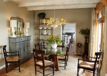 Weathered buffet and antique mirror give the cozy dining room a shabby chic look