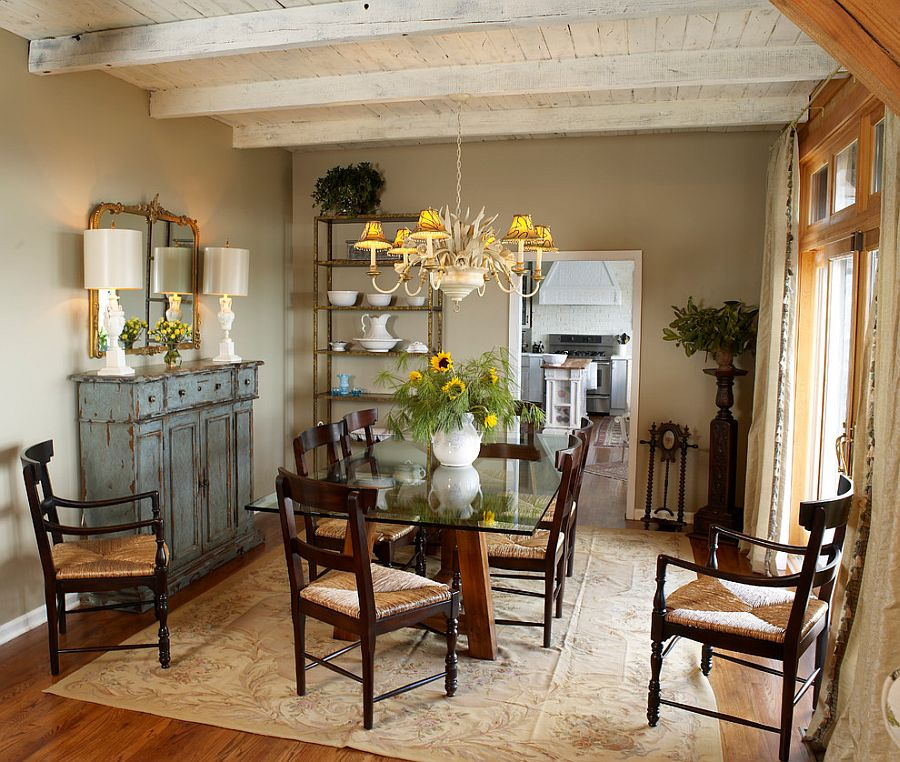Weathered buffet and antique mirror give the cozy dining room a shabby chic look [Design: Greeson & Fast Design]