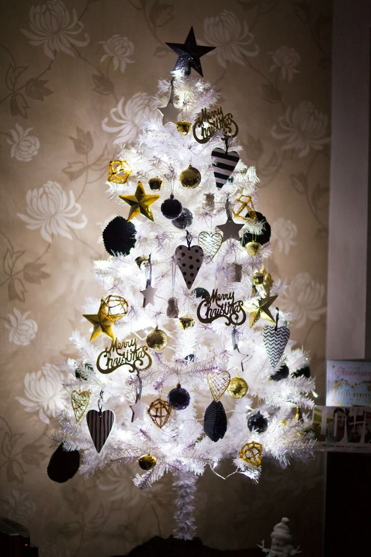 ... White Christmas all lit up with gold, black, and white ornaments