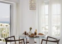 White cylindrical pendant light in a bright dining room