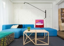 Whitewashed brick wall lets the colorful sofa and artwork standout visually