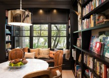 Window seat is a great addition for the cozy reading room and dining space combo