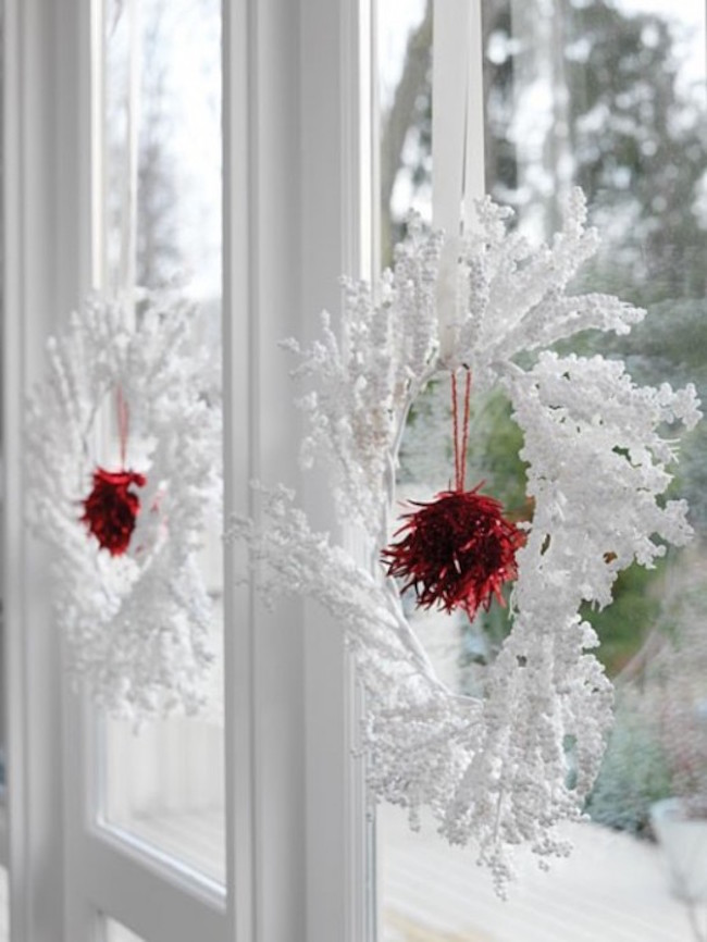 view in gallery wintery white and red wreaths hung in windows