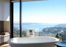 Wonderful framing of the distant view turns the minimal bathroom into a relaxing retreat