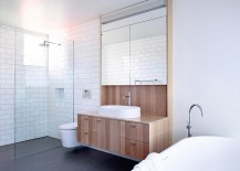 Wooden-bathroom-vanity-unit-brings-textural-variance-to-the-all-white-setting-217x155