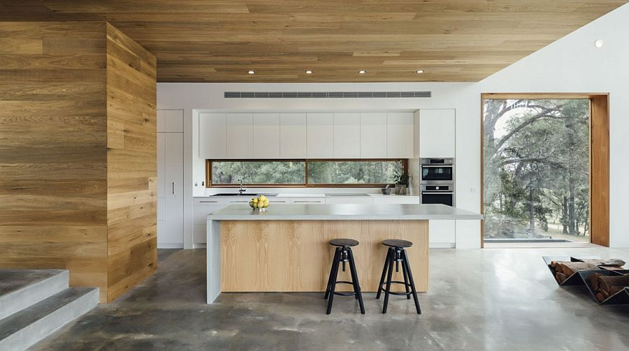 Wooden cladding creates a smart visual in the contemporary kitchen