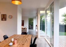 Wooden-dining-table-and-black-chairs-create-a-room-within-the-kitchen-with-ease-217x155