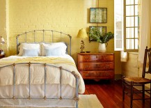 Yellow adds a fuzzy sheen to the eclectic bedroom