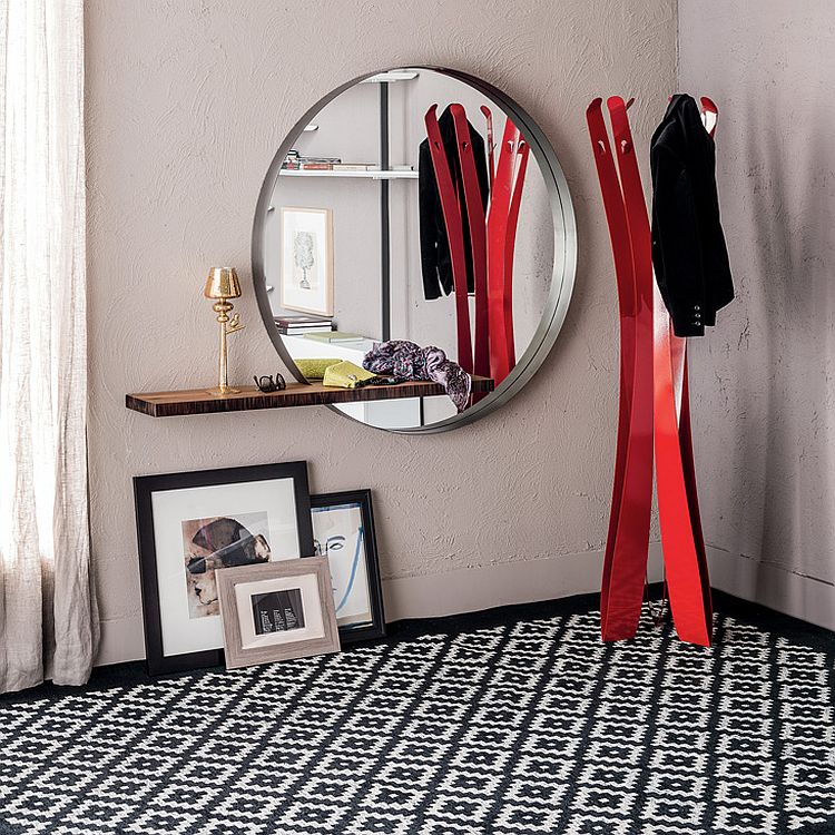 A perfect combination of round mirror and sleek shelf for the small urban interior