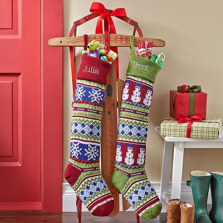 A sled holding two Christmas stockings