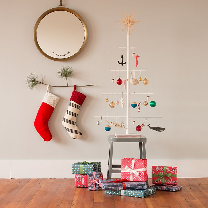 A small tree branch used as a Christmas stocking holder